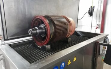 Ultrasonic cleaning of electric motor